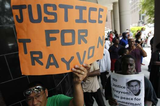 Protestors in Houston converged on the federal courthouse downtown Tuesday, July 16, 2013, in response to the acquittal of George Zimmerman in the shooting death of Sanford, Fla. teen Trayvon Martin. (Johnny Hanson / Houston Chronicle)