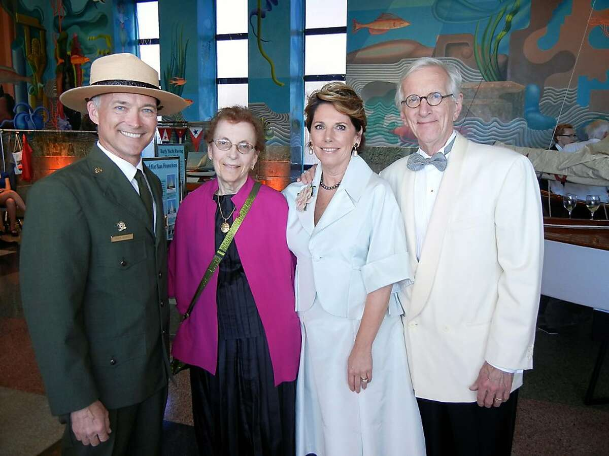 Maritime National Park Superintendent Craig Kenkel (at left) with Amy Meyer and Carol and John Tregenza at the Maritime Museum Gala. July 2013. By Catherine Bigelow