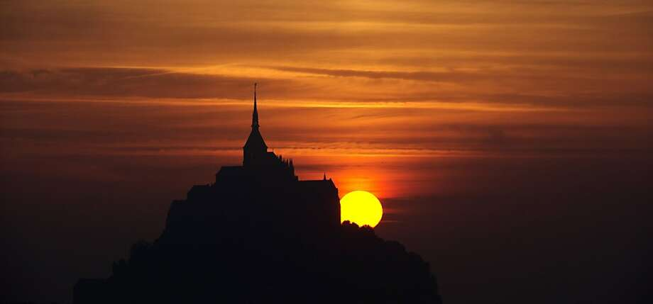 The sun sets on Mont Saint-Michel, a Unesco World Heritage site in western France. Photo: Damien Meyer, AFP/Getty Images