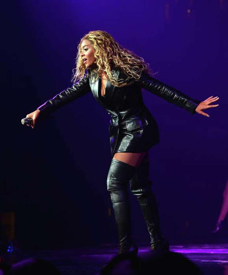"HOUSTON, TX - JULY 15:  Entertainer Beyonce performs on stage during ""The Mrs. Carter Show World Tour"" at the Toyota Center on July 15, 2013 in Houston, Texas. Beyonce wears a coat by Pucci and hosiery by Capezio. (Photo by Larry Busacca/PW/WireImage for Parkwood Entertainment) Photo: Larry Busacca/PW, WireImage For Parkwood Entertain / 2013 Larry Busacca/PW"