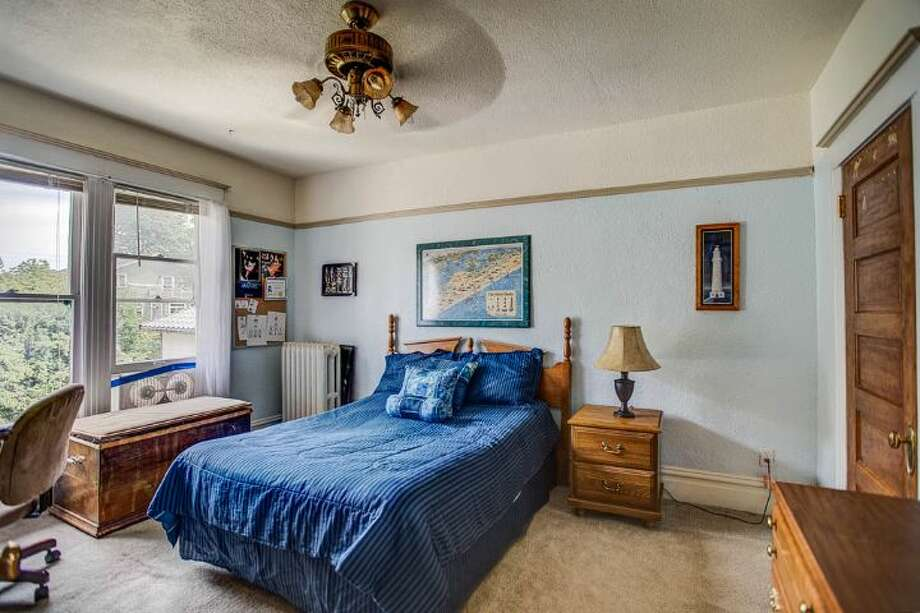 Bedroom of 324 18th Ave. The 2,090-square-foot Victorian, built in 1901, has four bedrooms, two bathrooms, a formal foyer, high ceilings, a sun room, a balcony, a front porch and a patio on a 5,120-square-foot lot. It's listed for $475,000. Photo: Courtesy Ben Carr, Windermere Real Estate