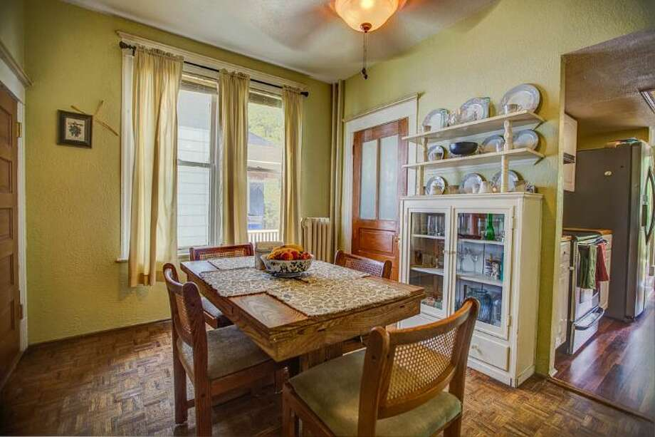 Breakfast room of 324 18th Ave. The 2,090-square-foot Victorian, built in 1901, has four bedrooms, two bathrooms, a formal foyer, high ceilings, a sun room, a balcony, a front porch and a patio on a 5,120-square-foot lot. It's listed for $475,000. Photo: Courtesy Ben Carr, Windermere Real Estate