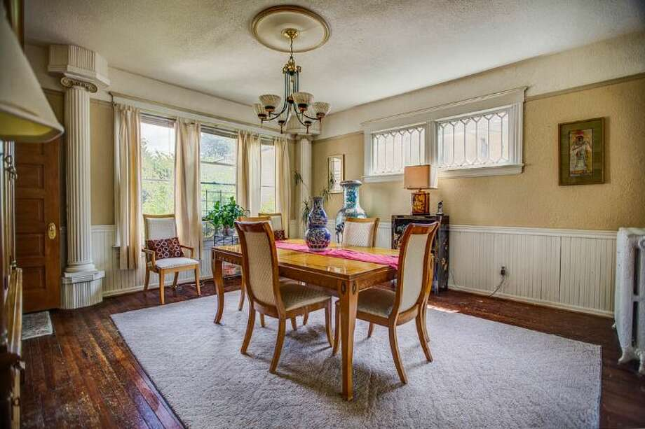 Dining room of 324 18th Ave. The 2,090-square-foot Victorian, built in 1901, has four bedrooms, two bathrooms, a formal foyer, high ceilings, a sun room, a balcony, a front porch and a patio on a 5,120-square-foot lot. It's listed for $475,000. Photo: Courtesy Ben Carr, Windermere Real Estate