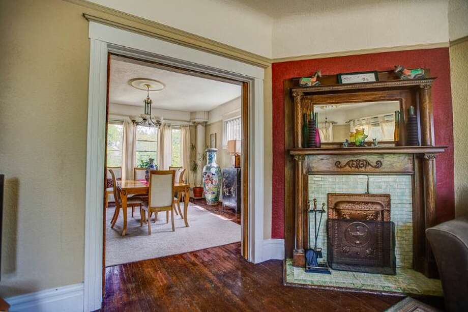 Living room of 324 18th Ave. The 2,090-square-foot Victorian, built in 1901, has four bedrooms, two bathrooms, a formal foyer, high ceilings, a sun room, a balcony, a front porch and a patio on a 5,120-square-foot lot. It's listed for $475,000. Photo: Courtesy Ben Carr, Windermere Real Estate