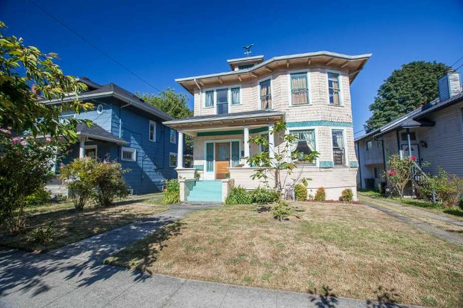 Finally, here's 324 18th Ave. The 2,090-square-foot Victorian, built in 1901, has four bedrooms, two bathrooms, a formal foyer, high ceilings, a sun room, a balcony, a front porch and a patio on a 5,120-square-foot lot. It's listed for $475,000. Photo: Courtesy Ben Carr, Windermere Real Estate