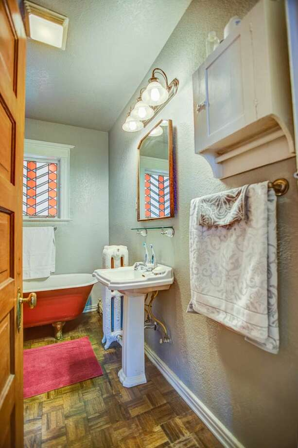 Bathroom of 324 18th Ave. The 2,090-square-foot Victorian, built in 1901, has four bedrooms, two bathrooms, a formal foyer, high ceilings, a sun room, a balcony, a front porch and a patio on a 5,120-square-foot lot. It's listed for $475,000. Photo: Courtesy Ben Carr, Windermere Real Estate