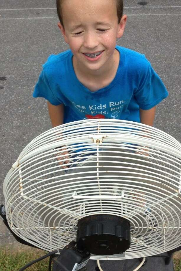 Cameron McCarthy,10, of Jonesboro, La., at a cooling station fan at the Saratoga County Fair in Ballston Spa, Tuesday, July 16, 2013. (John Carll D'Annibale/Times Union)