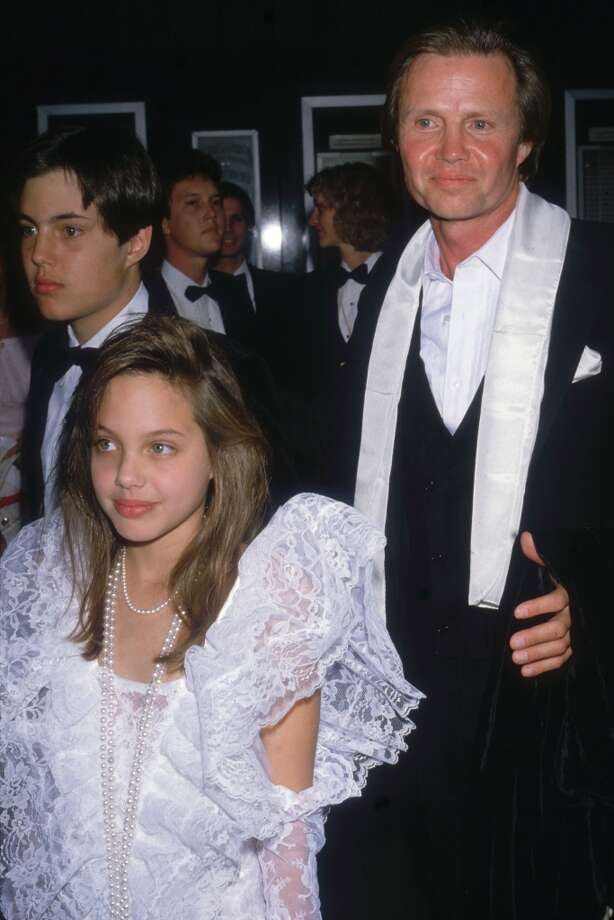 "Angelina Jolie was just a little girl when she played the daughter of her real father – Jon Voight's character – in the 1982 film ""Lookin' to Get Out."" Here she is in 1986."