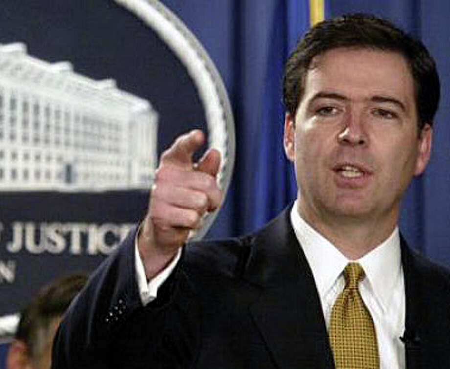 Westport resident James Comey, a former U.S. deputy attorney general and general counsel of Bridgewater Associates in Westport, has been nominated by President Obama to be the next FBI director. Photo: Associated Press / Westport News