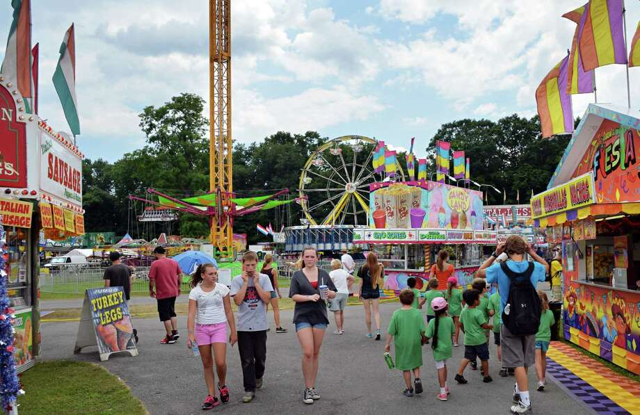 Opening day on the midway at the Saratoga County Fair in Ballston Spa, NY Tuesday July 16, 2013.  .(John Carl D'Annibale / Times Union) Photo: John Carl D'Annibale / 00023171A