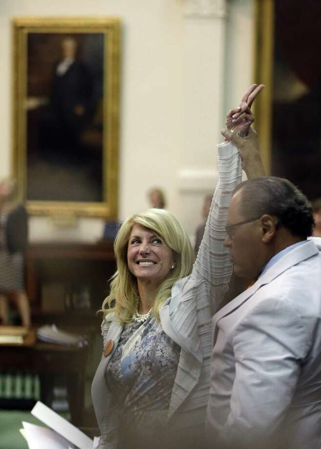 Sen. Wendy Davis, D-Fort Worth, celebrates as time runs out on an abortion bill in Austin June 26. Photo: AP File Photo