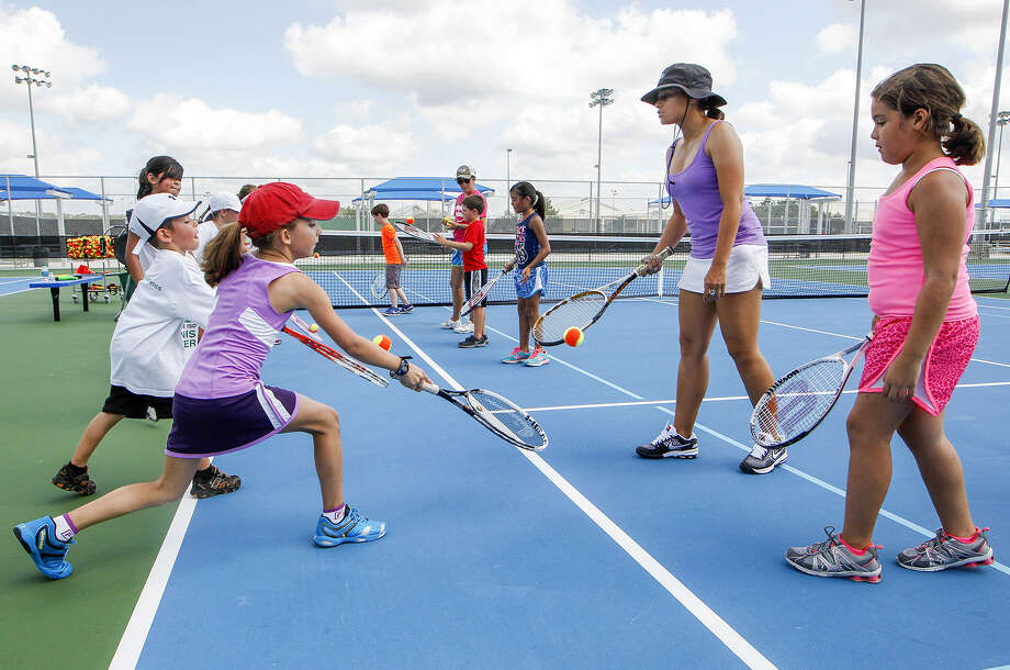 Iris Rendon (second from right) and Valerie Vasquez (center) conduct a Quick Start tennis camp for ages 5-12 at the new Northside Tennis Center at 12045 Leslie Road in Helotes. Photo: Marvin Pfeiffer / Northwest Weekly