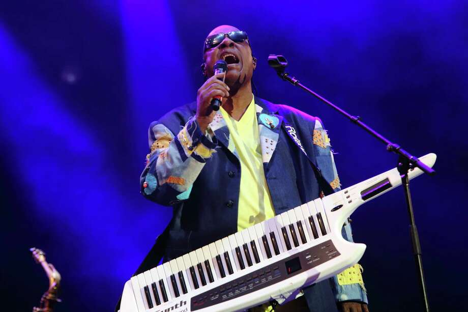 "FILE - In this May 19, 2013 file photo, Stevie Wonder performs at The Hangout Festival on in Gulf Shores, Ala. Wonder says he won't perform in Florida and other states where the ""stand your ground"" law. In a video posted on YouTube, the 63-year-old tells says at a concert Sunday, July 14, ""that until the 'stand your ground' law is abolished in Florida, I will never perform there again."" George Zimmerman shot and killed 17-year-old Trayvon Martin during a February 2012 confrontation in Sanford, Fla. Zimmerman said he fired his gun in self-defense. A six-member jury on Saturday acquitted Zimmerman of second-degree murder and manslaughter charges.   (Photo by John Davisson/Invision/AP, File) ORG XMIT: NYET353 Photo: John Davisson / Invision"