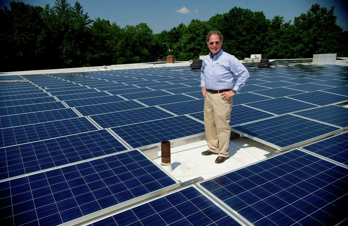 Sylvan Pomerantz, President of Temple Beth El in Stamford, poses for a photo among new solar panels installed on the temple's roof on Tuesday, July 16, 2013.