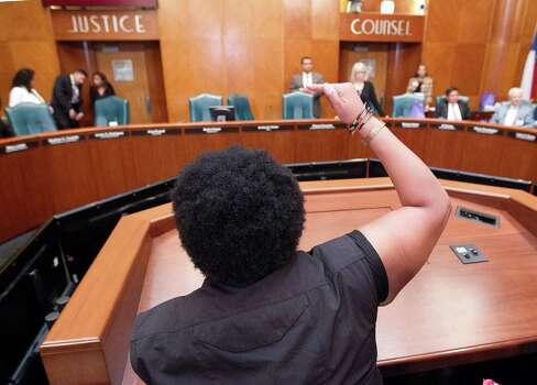 Krystal Muhammad of the New Black Panther Party along with about 100 protestors interrupt the City Council meeting at City Hall in response to George Zimmerman's acquittal in the death of unarmed, black Florida teen Trayvon Martin Tuesday, July 16, 2013, in Houston. 