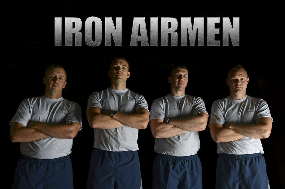 Capt. Richard Sandwick (left), Maj. Warren Carroll, Capt. Shane Praiswater and Capt. William Graff pose for a photo June 25, at Barksdale Air Force Base, La. The four airmen have successfully completed the Iron Airman Challenge. Photo: U.S. Air Force