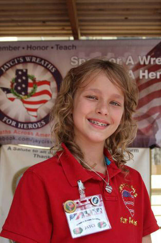 Jayci Derby, 12, launched a campaign to ensure that veterans' graves don't go without the recognition of a wreath last year at the Fort Sam Houston National Cemetery. Photo: File Photo