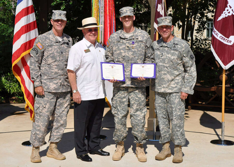 Tres Kleberg, Spc. Matthew Spang and Lt. Gen. William B. Caldwell during the Purple Heart ceremony, where Spang was presented two Purple Hearts - for wounds on two separate incidents. Photo: San Antonio Express-News File Photo