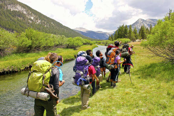 Students from several Houston high schools hiked through Yosemite National Park on a camping trip sponsored by The Woods Project in 2012.