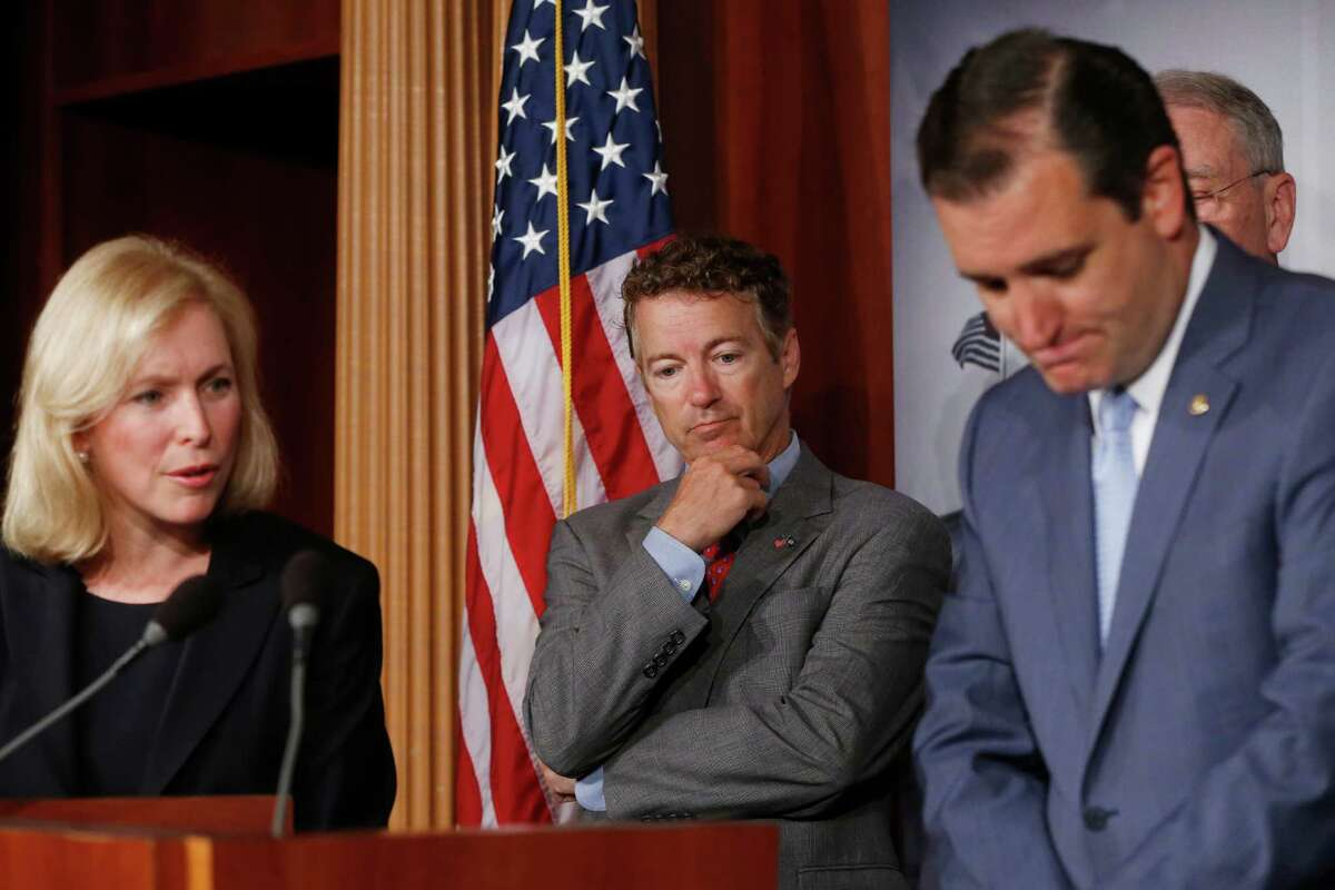 Sen. Kirsten Gillibrand, D-N.Y., left, Sen. Rand Paul, R-Ky., center, and Sen. Ted Cruz, R-Texas, right, speak to reporters during a news conference about a bill regarding military sexual assault cases on Capitol Hill in Washington, Tuesday, July 16, 2013.