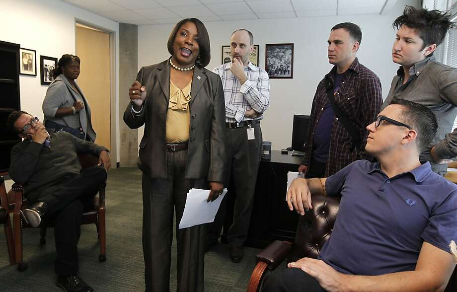 Karen Joubert, vice president of representation for Local 1021, updates staff and union members on the proposed health care rate increase. Photo: Michael Macor, San Francisco Chronicle