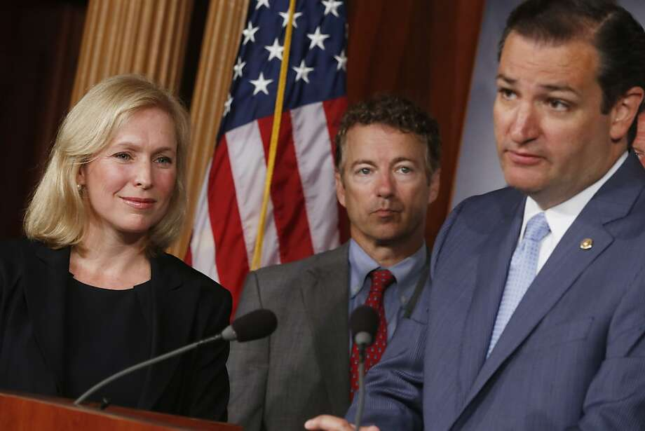 Sens. Kirsten Gillibrand, D-N.Y., and Rand Paul, R-Ky. (center), listen as Sen. Ted Cruz, R-Texas, speaks to reporters on Capitol Hill about Gillibrand's bill on military sexual assaults. Photo: Charles Dharapak, Associated Press