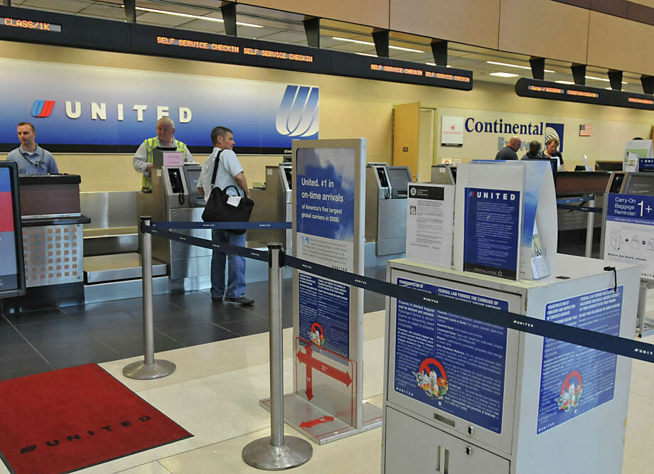 The United Airlines and Continental Airlies ticket counters at the Albany International Airport in Colonie, NY on May 3, 2010. For story on the two airlines merging. (Lori Van Buren / Times Union) Photo: LORI VAN BUREN / 00008567A