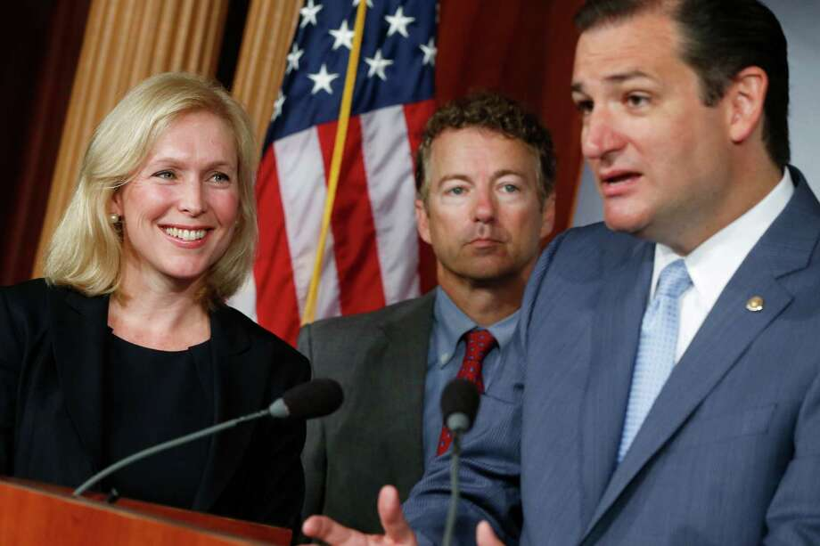 Sen. Kirsten Gillibrand, D-N.Y., left, with GOP Sens. Ted Cruz, right, and Rand Paul, seeks to bypass the military chain of command in sex assault cases. Photo: Charles Dharapak, STF / AP