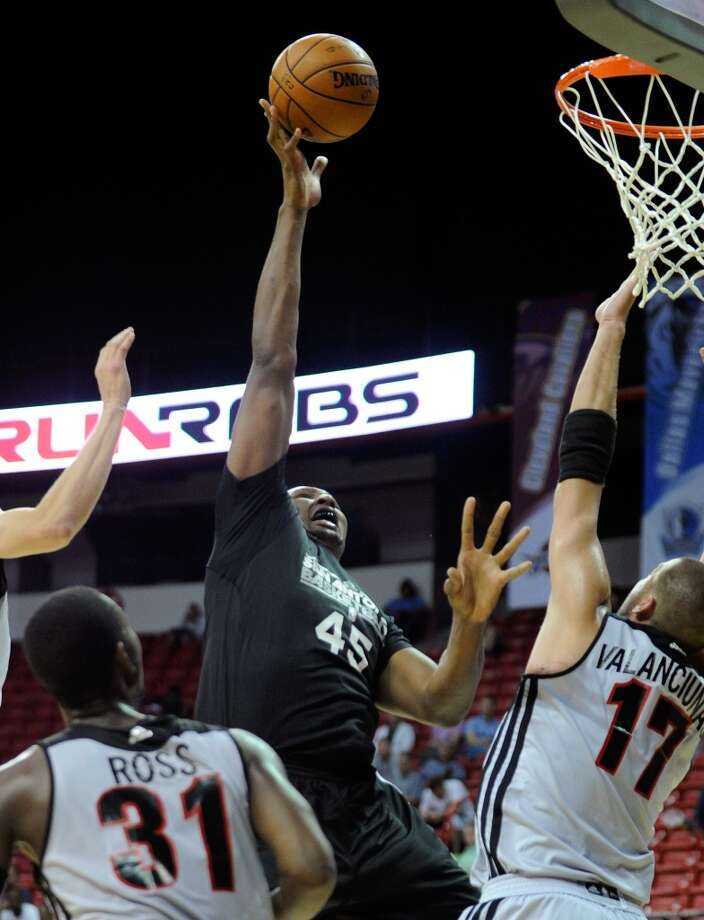 San Antonio's Dexter Pittman shoots against the Toronto Raptors during a NBA Summer League basketball game at the Thomas & Mack Center on Sunday, July 14, 2013 in Las Vegas. (Photo by David Becker)