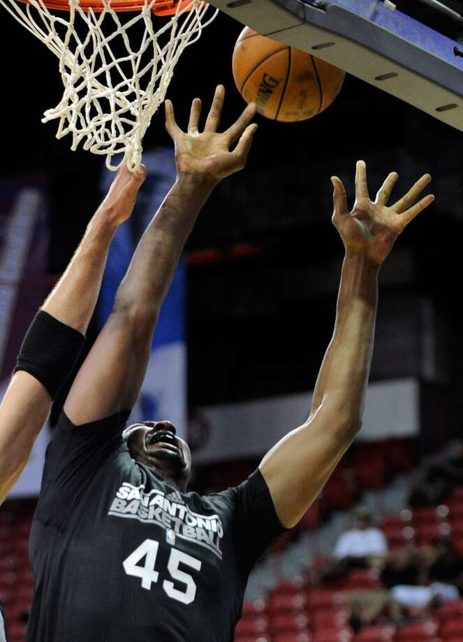 San Antonio's Dexter Pittman grabs a rebound against the Toronto Raptors during a NBA Summer League basketball game at the Thomas & Mack Center on Sunday, July 14, 2013 in Las Vegas. (Photo by David Becker)