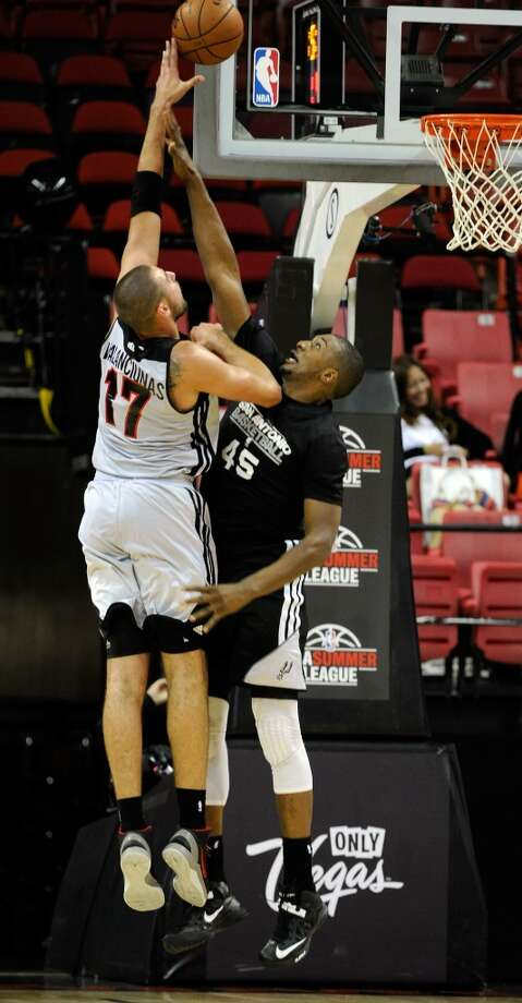 San Antonio's Dexter Pittman (45) attempts to block a shot by  Toronto's Jonas Valanciunas during a NBA Summer League basketball game at the Thomas & Mack Center on Sunday, July 14, 2013 in Las Vegas. (Photo by David Becker)