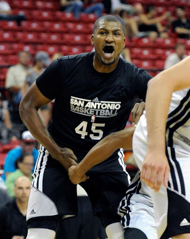 San Antonio's Dexter Pittman appears to be fouled below the belt during a NBA Summer League basketball game against Toronto at the Thomas & Mack Center on Sunday, July 14, 2013 in Las Vegas. (Photo by David Becker)