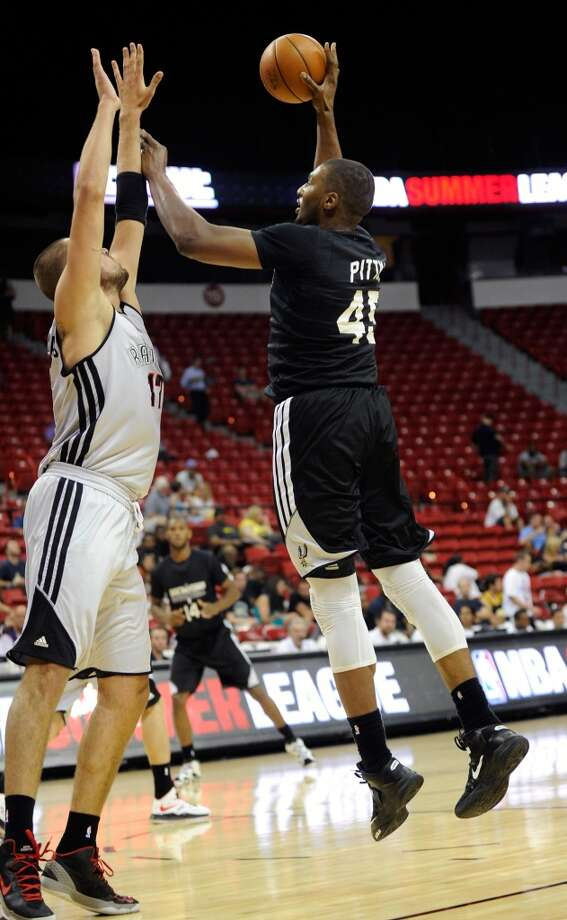 San Antonio's Dexter Pittman (45) shoots over Toronto's Jonas Valanciunas during a NBA Summer League basketball game at the Thomas & Mack Center on Sunday, July 14, 2013 in Las Vegas. (Photo by David Becker)