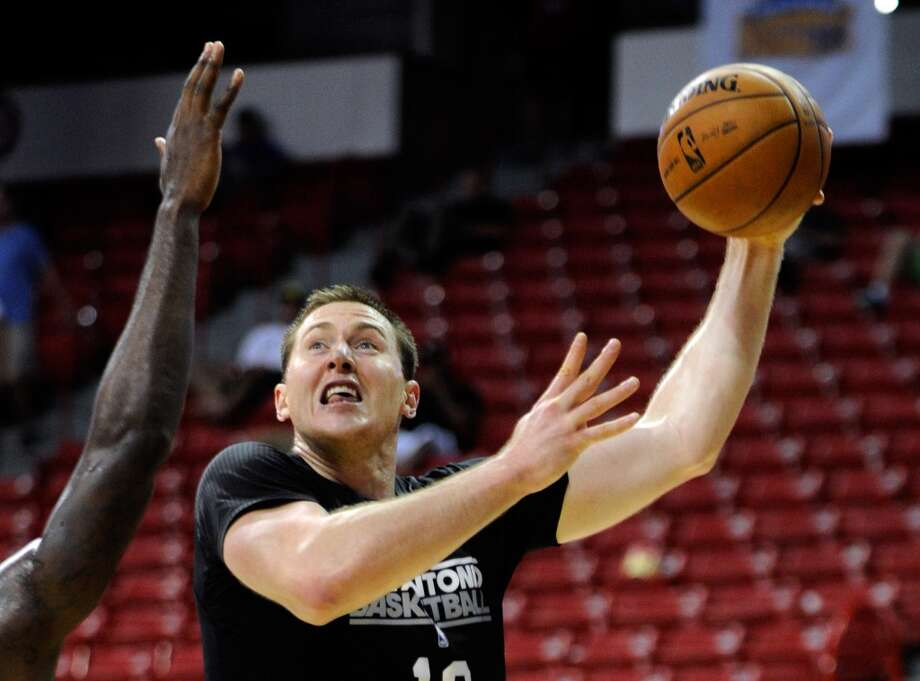 San Antonio's Aron Baynes shoots against Toronto during a NBA Summer League basketball game at the Thomas & Mack Center on Sunday, July 14, 2013 in Las Vegas. (Photo by David Becker)