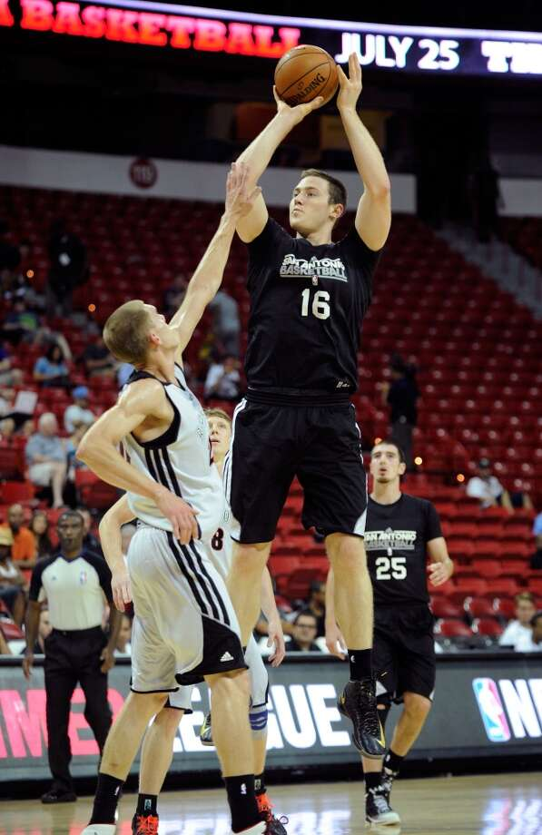 San Antonio's Aron Baynes (16) shoots against Toronto during a NBA Summer League basketball game at the Thomas & Mack Center on Sunday, July 14, 2013 in Las Vegas. (Photo by David Becker)