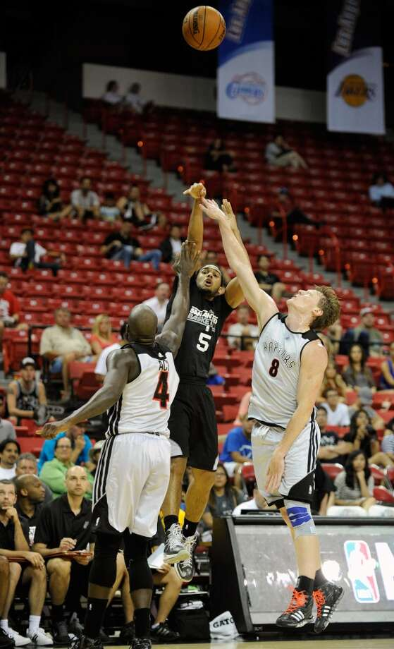 San Antonio's Cory Joseph (5) shoots against Toronto during a NBA Summer League basketball game at the Thomas & Mack Center on Sunday, July 14, 2013 in Las Vegas. (Photo by David Becker)
