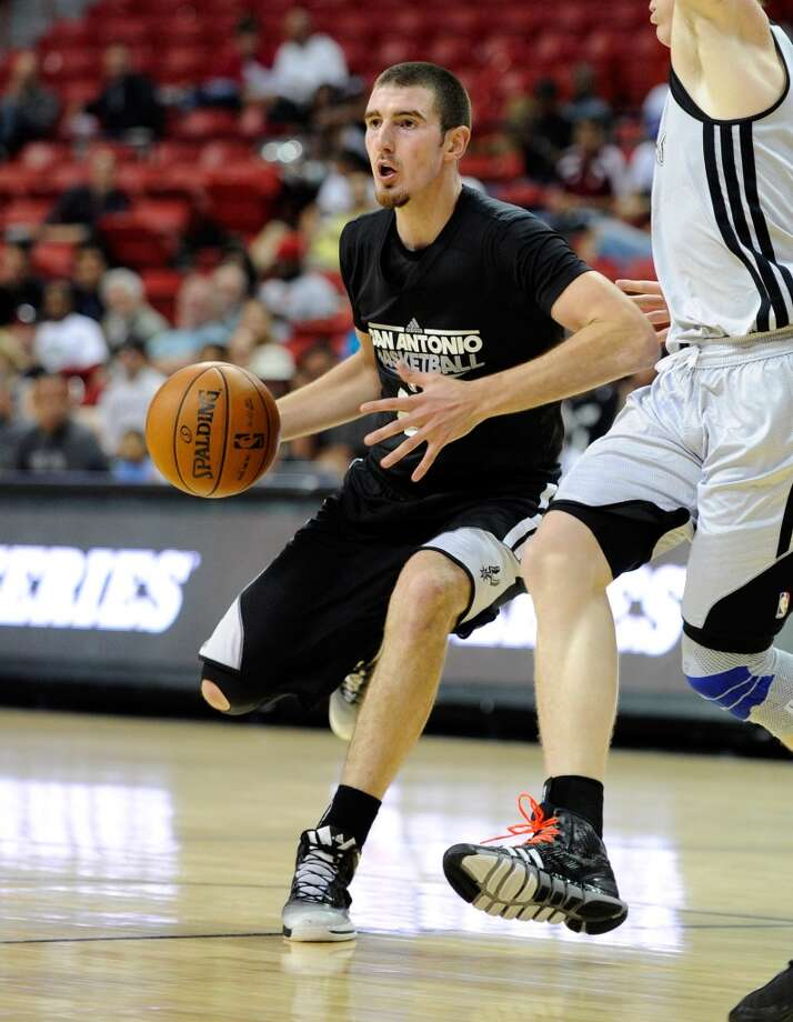 San Antonio's Nando De Colo looks to pass against Toronto during a NBA Summer League basketball game at the Thomas & Mack Center on Sunday, July 14, 2013 in Las Vegas. (Photo by David Becker)
