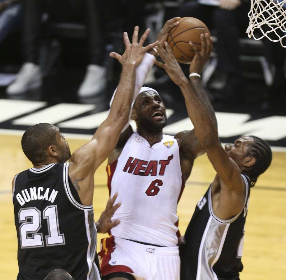 San Antonio Spurs' Tim Duncan and Kawhi Leonard double team Miami Heat's LeBron James as he goes to the hoopduring the second half of Game 7 of the NBA Finals at American Airlines Arena on Thursday, June 20, 2013 in Miami. (Jerry Lara/San Antonio Express-News) Photo: San Antonio Express-News