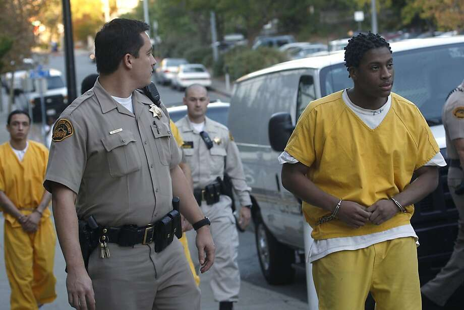 Marcelles Peter (right) leaves court in 2010 after a hearing in the rape of a 16-year-old girl outside a school dance in 2009. Photo: Liz Hafalia, The Chronicle