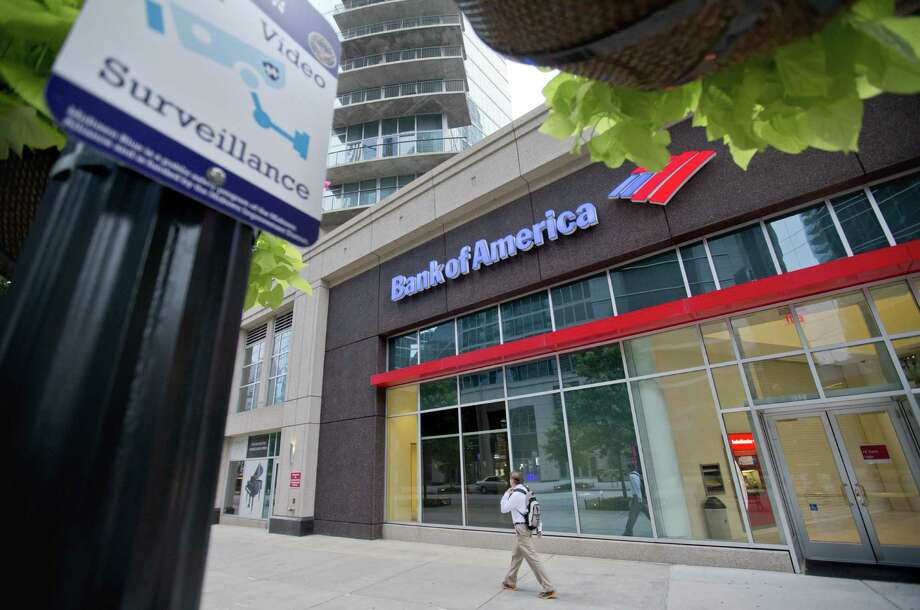 A surveillance sign is posted outside a Bank of America branch on Atlanta's famed Peachtree Street. Banks large and small are girding for an elaborate drill this week. Photo: Photos By David Goldman / Associated Press