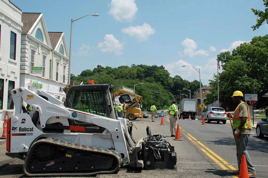 "John Irby worked construction on the Post Road as heat-wave temperatures crested in the mid-90s Tuesday afternoon. ""This definitely is humid, heavy and hot,"" he said. Photo: Jarret Liotta / Westport News contributed"