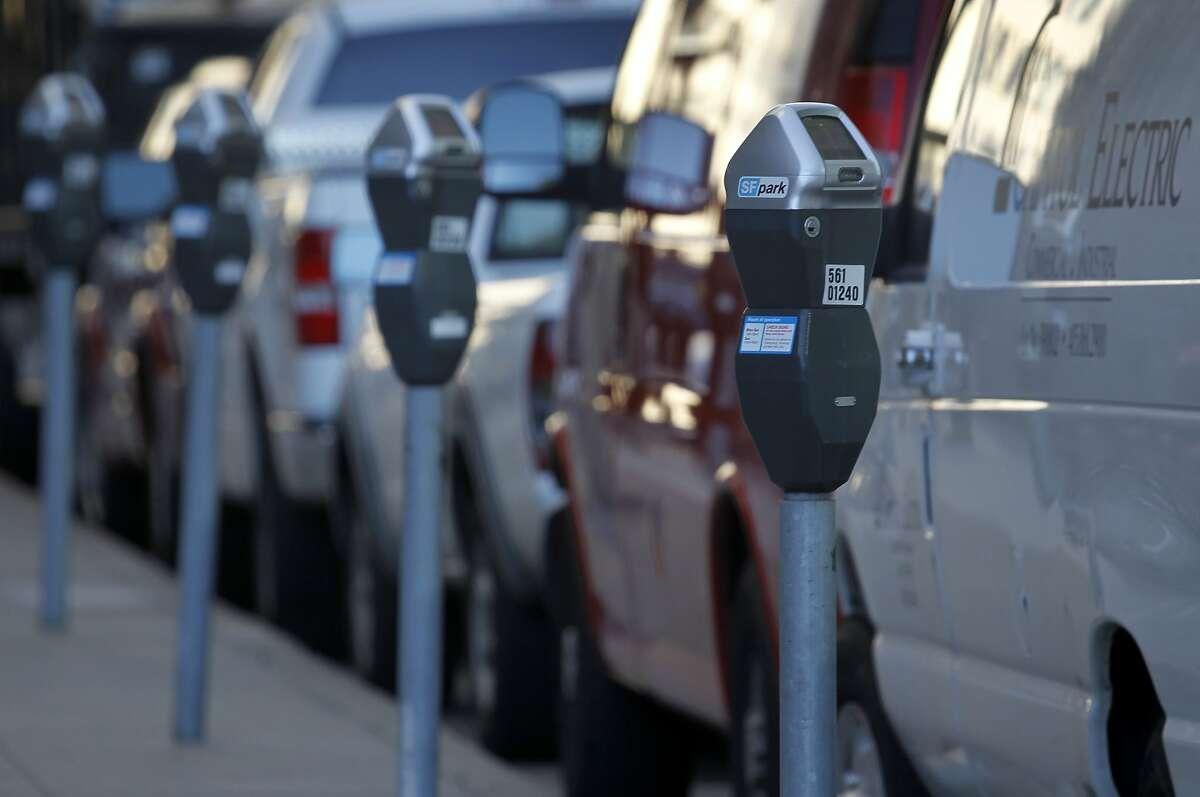Cars and vans are parked in metered spaces on Main Street in San Francisco, Calif. on Friday, June 28, 2013. The violation for parking at expired meters jumps to $74 on July 1, making it the most expensive fine in the country.