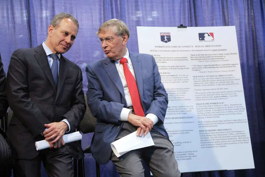 Baseball Commissioner Bud Selig, right, and New York Attorney General Eric T. Schneiderman speak to each other next to a poster outlining Major League Baseball's policies against harassment and discrimination based on sexual orientation, during a news conference Tuesday, July 16, 2013, in New York. The league announced its new policy during All-Star Game festivities on Tuesday with the players' union and Schneiderman, who helped draft the agreement.  (AP Photo/Mary Altaffer) ORG XMIT: NYMA104 Photo: Mary Altaffer / AP