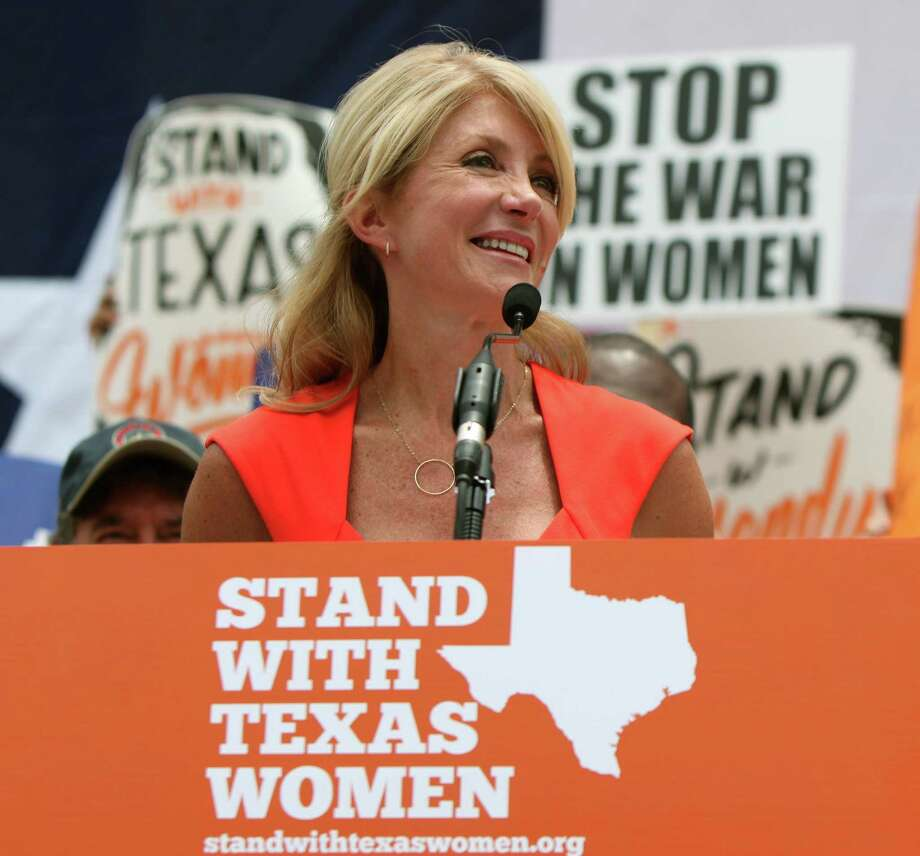 Texas Sen. Wendy Davis, D-Fort Worth, leads a rally on the first day of Perry's second special session. Abortion proved the No. 1 issue this year, but lawmakers tackled other important issues. Photo: Erich Schlegel, Stringer / 2013 Getty Images