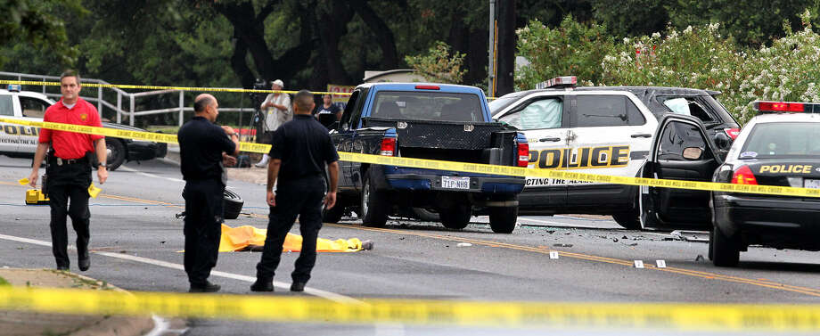 """Police work the scene of a fatal officer-involved shooting in the 8900 block of Datapoint Drive. Officers had responded to a call about a man who was yelling at people, saying: """"I am the king! Give me your truck!"""" Photo: John Davenport / San Antonio Express-News"""