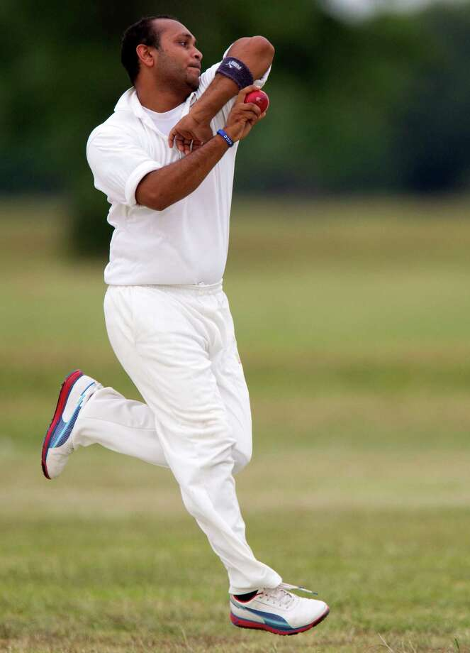 Houston Indian Cricket Club bowler Foram Patel propels the ball toward a Houston West Indies batsman during a cricket match at George Bush Park on Sunday, June 30, 2013, in Houston. Photo: J. Patric Schneider, For The Chronicle / © 2013 Houston Chronicle