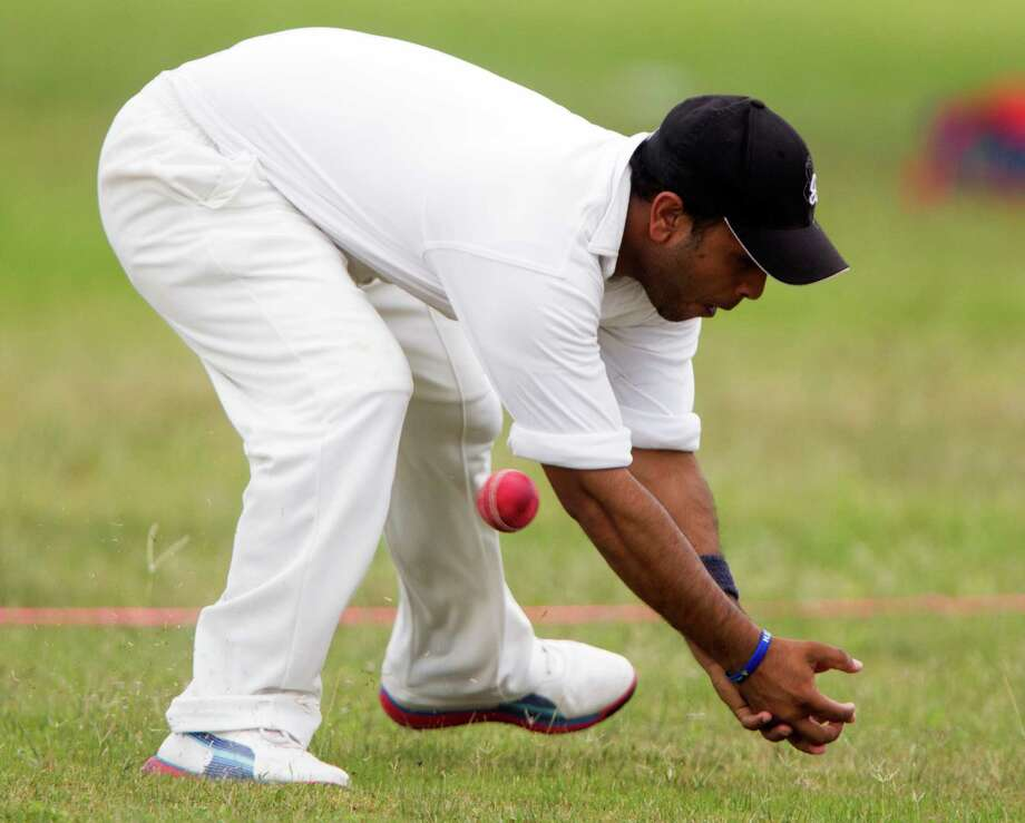 Houston Indian Cricket Club member Foram Patel misses the ball during a cricket match against the Houston West Indies at George Bush Park on Sunday, June 30, 2013, in Houston. Photo: J. Patric Schneider, For The Chronicle / © 2013 Houston Chronicle