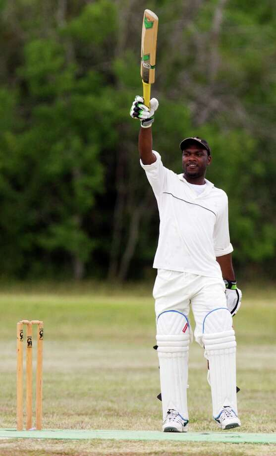 Houston West Indies batsman Travis Wynter waves to his team members as he prepares to bat during a cricket match against the Houston Indian Cricket Club at George Bush Park on Sunday, June 30, 2013, in Houston. Photo: J. Patric Schneider, For The Chronicle / © 2013 Houston Chronicle