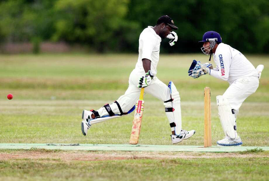 Houston West Indies batsman Travis Wynter runs to the wicket past Houston Indian Cricket Club wicket-keeper Monik Patel during a cricket match at George Bush Park on Sunday, June 30, 2013, in Houston. Photo: J. Patric Schneider, For The Chronicle / © 2013 Houston Chronicle