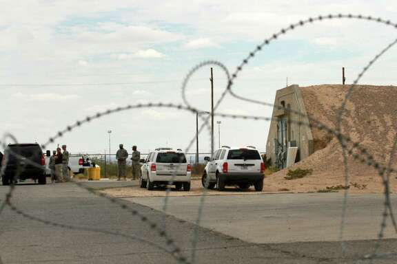 Chemical and nuclear weapons experts are seen inside an area where radiation contamination was discovered coming out of a bunker in Fort Bliss. Military officials said Tuesday that they've found radiation contamination from nuclear weapons stored five decades ago.